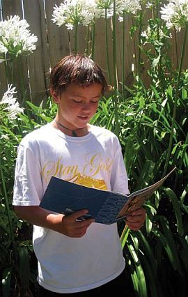 Image of boy reading.